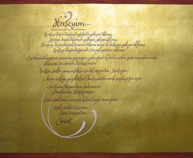 Kalligrafie auf vergoldetem Buettenpapier