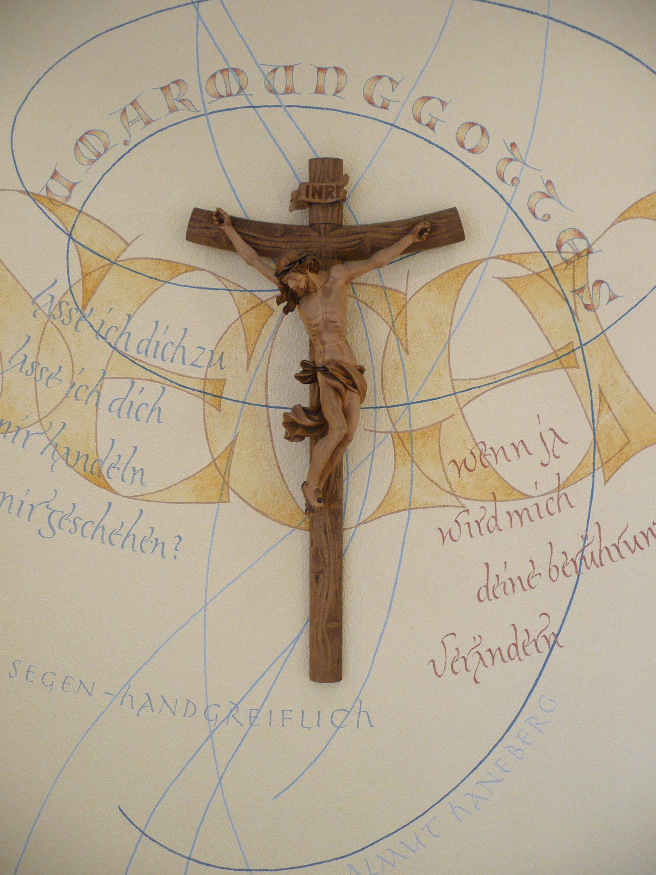 Kruzifix umgeben von einer Kalligrafie