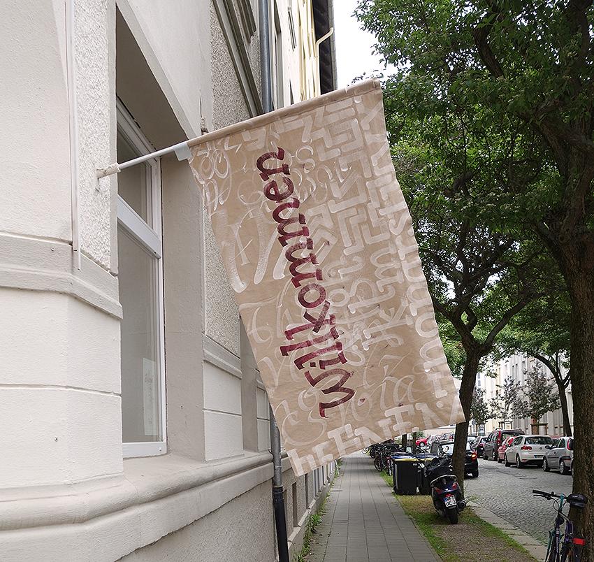 Kalligrafie Willkommen in Rot